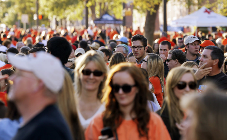 Thousands of people fill University Ave. to look at house decorations during Walkaround at Oklahoma State University's homecoming in Stillwater, Okla., Friday, Oct. 19, 2012. Photo by Nate Billings, The Oklahoman
