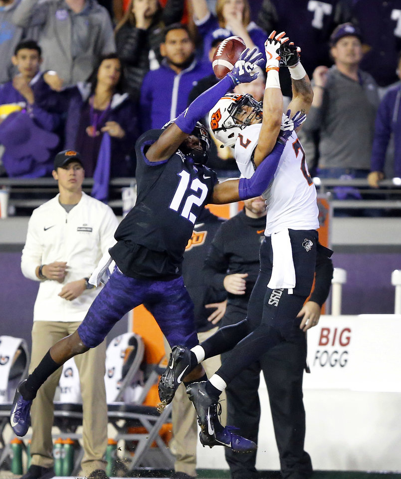 Photo - TCU cornerback Jeff Gladney (12) keeps Oklahoma State wide receiver Tylan Wallace (2) from catching a second-half pass during an NCAA college football game Saturday, Nov. 24, 2018, in Fort Worth, Texas. TCU won 31-24. (Tom Fox/The Dallas Morning News via AP)