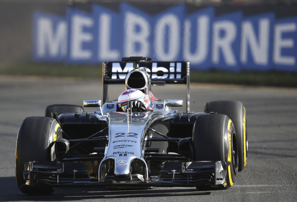 Photo - McLaren driver Jenson Button of Britain controls his car on turn five during the second practice session at Albert Park ahead of the Australian Formula One Grand Prix in Melbourne, Australia, Friday, March 14, 2014. Hamilton clocked the fastest time ahead of team mate Nico Rosberg. (AP Photo/Rob Griffith)