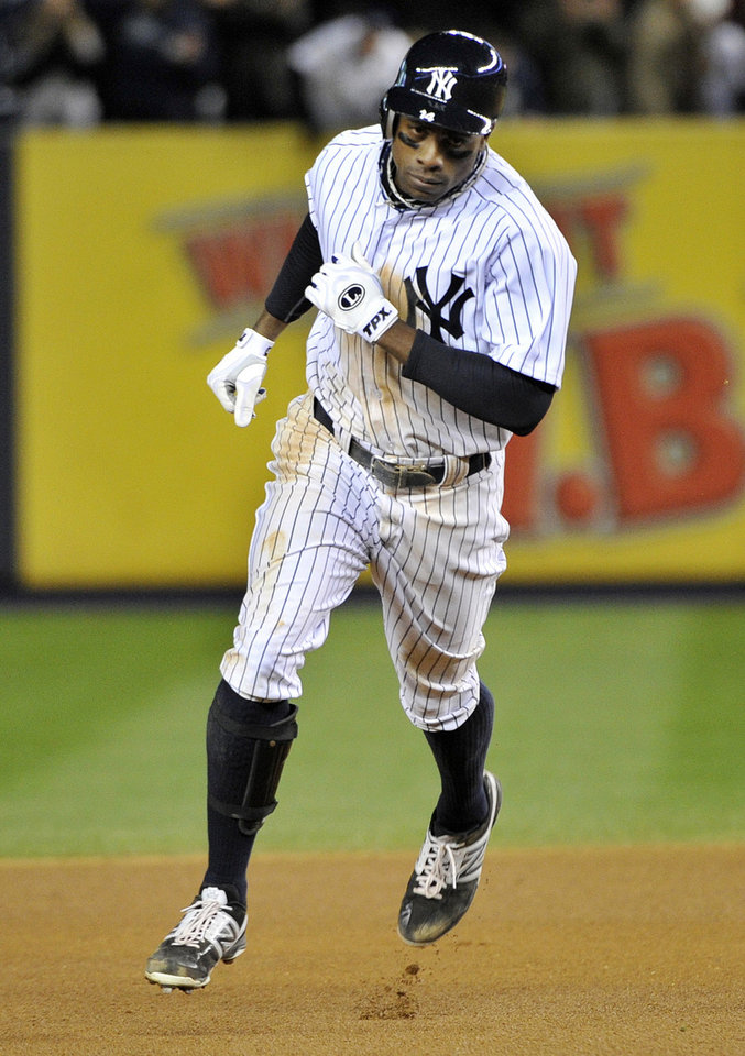 New York Yankees\' Curtis Granderson runs the bases after hitting a solo home run during the seventh inning of Game 5 of the American League division baseball series against the Baltimore Orioles, Friday, Oct. 12, 2012, in New York. (AP Photo/Bill Kostroun)