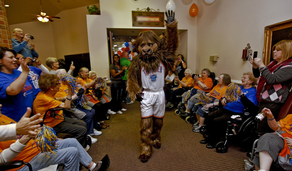 Rumble is greeted by the fans as he enters the room during the Oklahoma City Thunder's 1000th community appearance at Ranchwood Nursing Home on Tuesday, Nov. 27, 2012, in Yukon, Okla.   Photo by Chris Landsberger, The Oklahoman