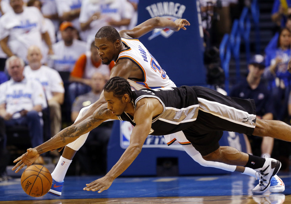 Photo - Oklahoma City's Kevin Durant (35) and San Antonio's Kawhi Leonard (2) chase the ball during Game 4 of the Western Conference Finals in the NBA playoffs between the Oklahoma City Thunder and the San Antonio Spurs at Chesapeake Energy Arena in Oklahoma City, Tuesday, May 27, 2014. Oklahoma City won 105-92. Photo by Nate Billings, The Oklahoman
