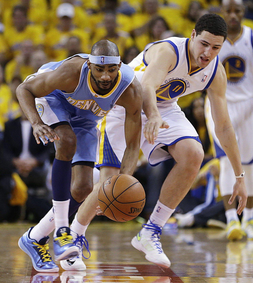 Photo - Denver Nuggets forward Corey Brewer, left, and Golden State Warriors guard Klay Thompson (11) chase a loose ball during the first half of Game 4 in a first-round NBA basketball playoff series, Sunday, April 28, 2013, in Oakland, Calif. (AP Photo/Ben Margot)