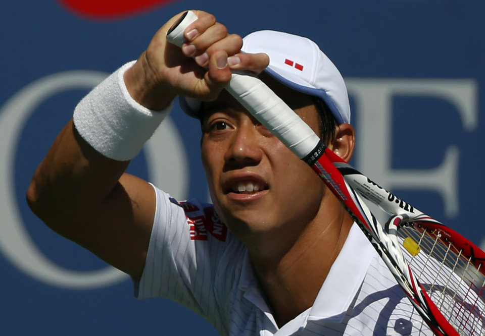 Photo - Kei Nishikori, of Japan, follows through on a shot to Pablo Andujar, of Spain, during the second round of the 2014 U.S. Open tennis tournament, Thursday, Aug. 28, 2014, in New York. (AP Photo/Matt Rourke)