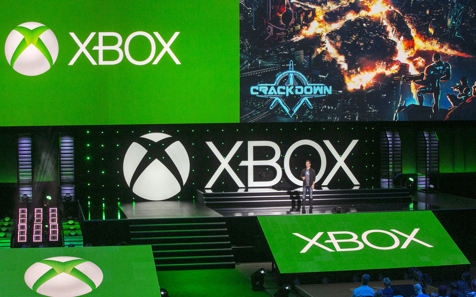 """Photo -  Phil Spencer, head of Microsoft's Xbox division and Microsoft Studios, presents a fresh installment of the open-world romp """"Crackdown,"""" for the Xbox One, during a presentation ahead of the Electronic Entertainment Expo at the University of Southern California's Galen Center on Monday in Los Angeles.  AP Photo   Damian Dovarganes -  AP"""
