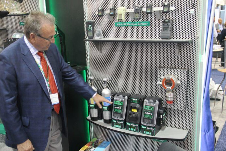 Greger Erickson, customer development manager for MSA North America, points out some of the safety equipment his company sells.