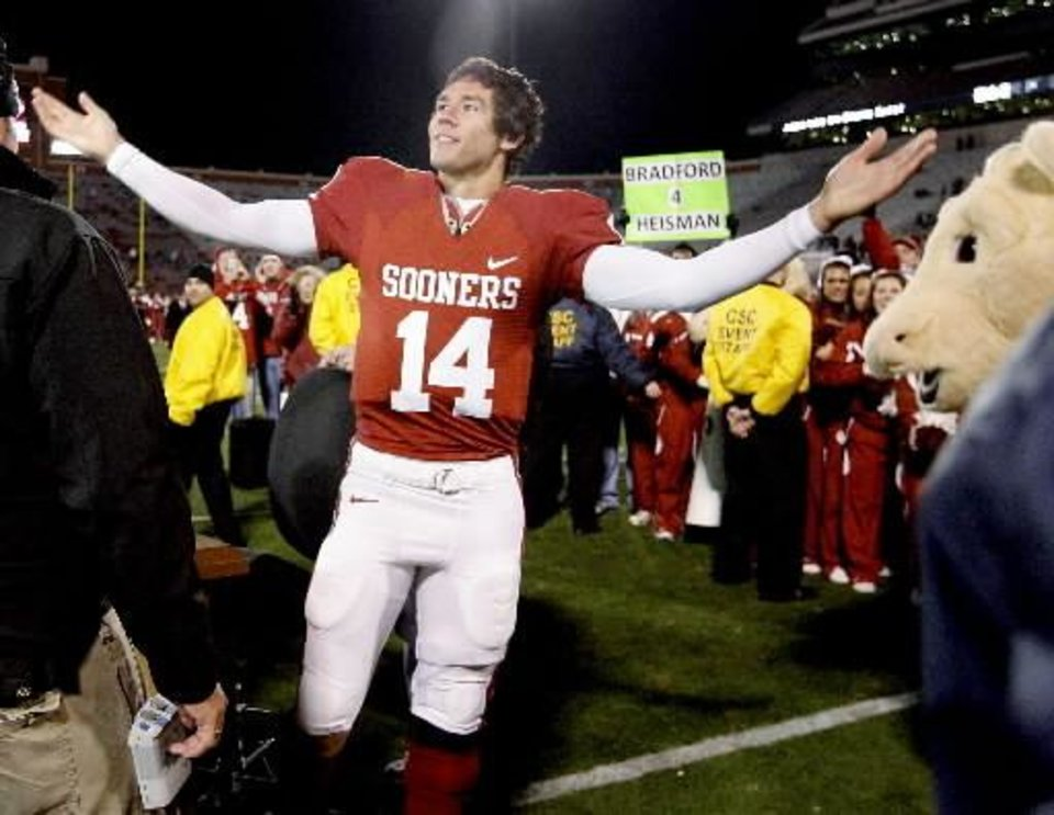 Photo - OU's Sam Bradford waves to the crowd after the college football game between the University of Oklahoma Sooners and Texas Tech University at Gaylord Family -- Oklahoma Memorial Stadium in Norman, Okla., Saturday, Nov. 22, 2008. BY BRYAN TERRY, THE OKLAHOMAN