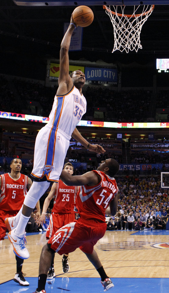 Oklahoma City's Kevin Durant (35) shoots over Houston's Patrick Patterson (54) during the NBA basketball game between the Oklahoma City Thunder and the Houston Rockets at the Chesapeake Energy Arena, Tuesday, March 13, 2012. Photo by Sarah Phipps, The Oklahoman.