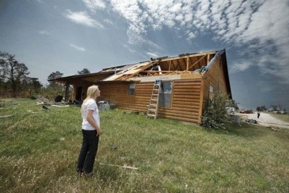 Kara Stanley shows damage to her home which doubled as the Pug Sanctuary on Thursday, June 9, 2011, in Dibble, Okla.  Pug Sanctuary Inc.'s facility was heavily damaged in May 24 and Stanley wants to rebuild. Photo by Steve Sisney, The Oklahoman ORG XMIT: KOD