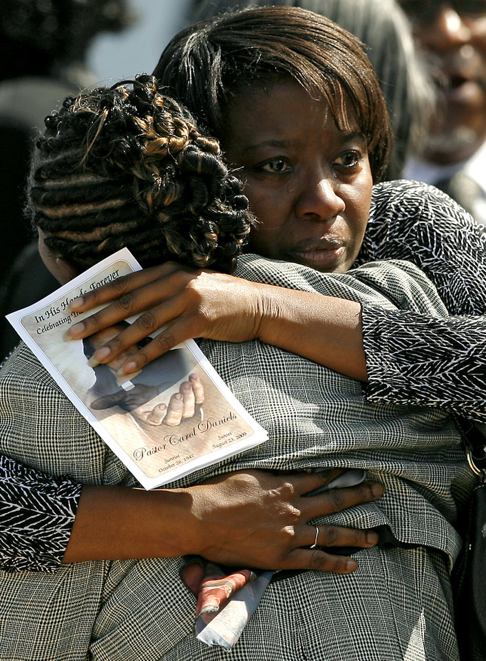 Photo - REV. CAROL DANIELS / MURDER / HOMICIDE: REV. CAROL DANIELS / MURDER / HOMICIDE: Mourners gather outside Greater New Zion Baptist Church following the funeral of Pastor Carol Daniels on Monday, August 31, 2009.  By John Clanton, The Oklahoman ORG XMIT: KOD