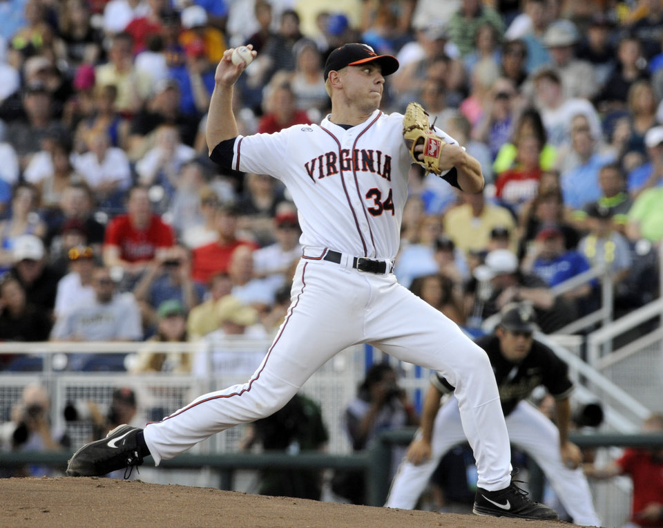 Photo - Virginia pitcher Artie Lewicki throws a pitch in the second inning of Game 3 of the best-of-three NCAA baseball College World Series finals against Vanderbilt in Omaha, Neb., Wednesday, June 25, 2014. (AP Photo/Eric Francis)