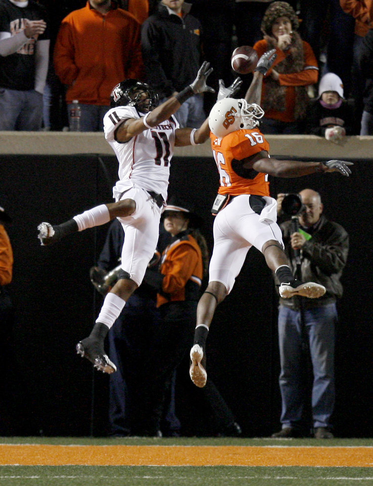 Photo - OSU's Perrish Cox (16) breaks up a pass intended for Texas Tech's Tramain Swindall (11)  during the college football game between Oklahoma State University (OSU) and Texas Tech University (TTU) at Boone Pickens Stadium in Stillwater, Okla. Saturday, Nov. 14, 2009. Photo by Sarah Phipps, The Oklahoman ORG XMIT: KOD