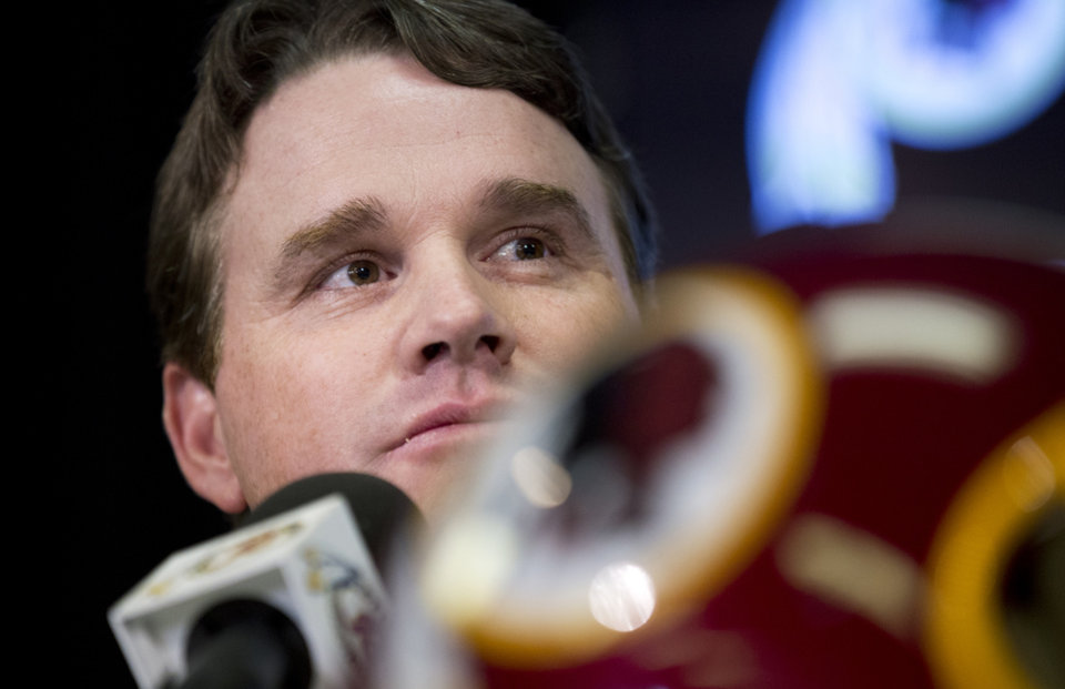 Photo - New Washington Redskins head coach Jay Gruden, attends a news conference at the Redskins Park in Ashburn, Va., Thursday, Jan. 9, 2014. Jay Gruden was introduced as the new Washington Redskins head coach, replacing Mike Shanahan and becoming the team's eighth head coach since Daniel Snyder purchased the franchise in 1999. (AP Photo/Manuel Balce Ceneta)
