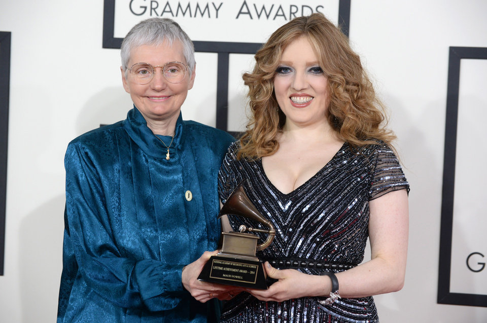 Photo - Karen A. Shaffer, left, and Rachel Barton Pine with the Lifetime Achievement Grammy on behalf of Maud Powell arrive at the 56th annual Grammy Awards at Staples Center on Sunday, Jan. 26, 2014, in Los Angeles. (Photo by Jordan Strauss/Invision/AP)