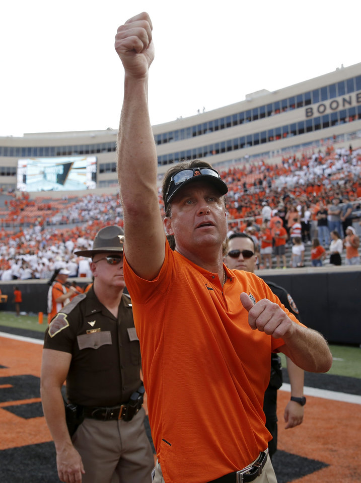 Photo - Oklahoma State head coach Mike Gundy waves to fans following a college football game between the Oklahoma State Cowboys (OSU) and the Boise State Broncos at Boone Pickens Stadium in Stillwater, Okla., Saturday, Sept. 15, 2018. OSU won 44-21. Photo by Sarah Phipps, The Oklahoman