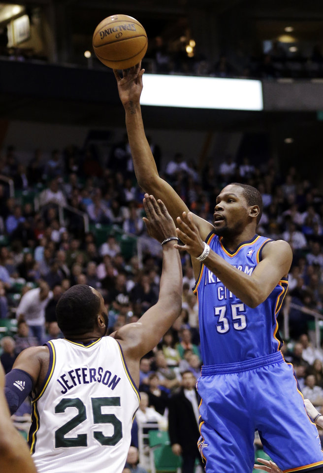 Oklahoma City Thunder's Kevin Durant (35) shoots as Utah Jazz's Al Jefferson (25) defends in the first quarter during an NBA basketball game, Tuesday, April 9, 2013, in Salt Lake City. (AP Photo/Rick Bowmer) ORG XMIT: UTRB105