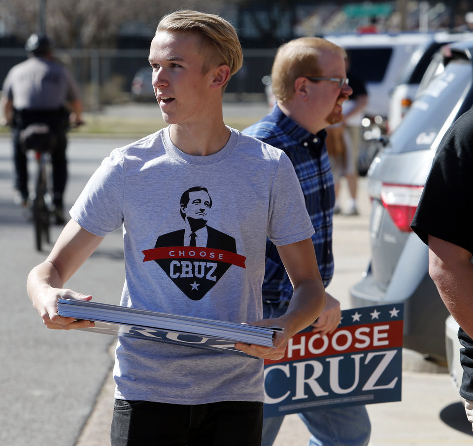 Photo - Wes Engle, Durant, passes out Cruz Signs outside the Chevy Bricktown Event Center as Republican presidential candidate Ted Cruz is scheduled to speak as part of the Oklahoma City Courageous Conservatives Rally on Sunday, Feb. 28, 2016 in Oklahoma City, Okla.  Photo by Steve Sisney, The Oklahoman