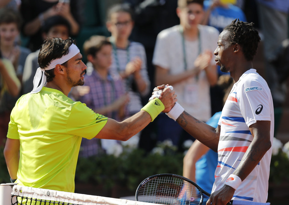 Photo - France's Gael Monfils, right, and Italy's Fabio Fognini shake hands after their third round match of  the French Open tennis tournament at the Roland Garros stadium, in Paris, France, Saturday, May 31, 2014. (AP Photo/David Vincent)