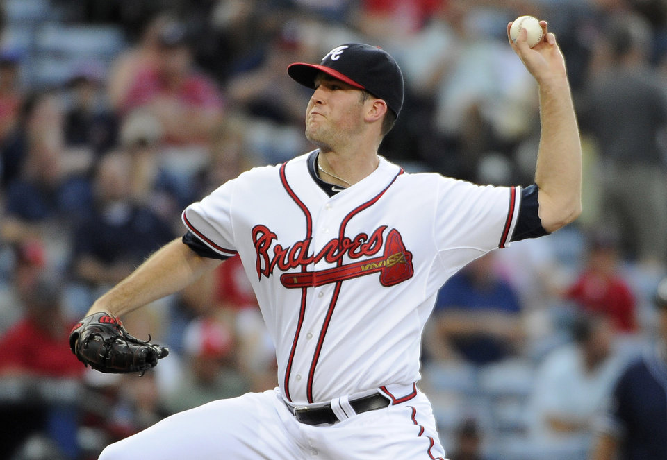 Photo - Atlanta Braves starting pitcher Alex Wood delivers to the San Diego Padres during the first inning of a baseball game Friday, July 25, 2014, in Atlanta. (AP Photo/David Tulis)