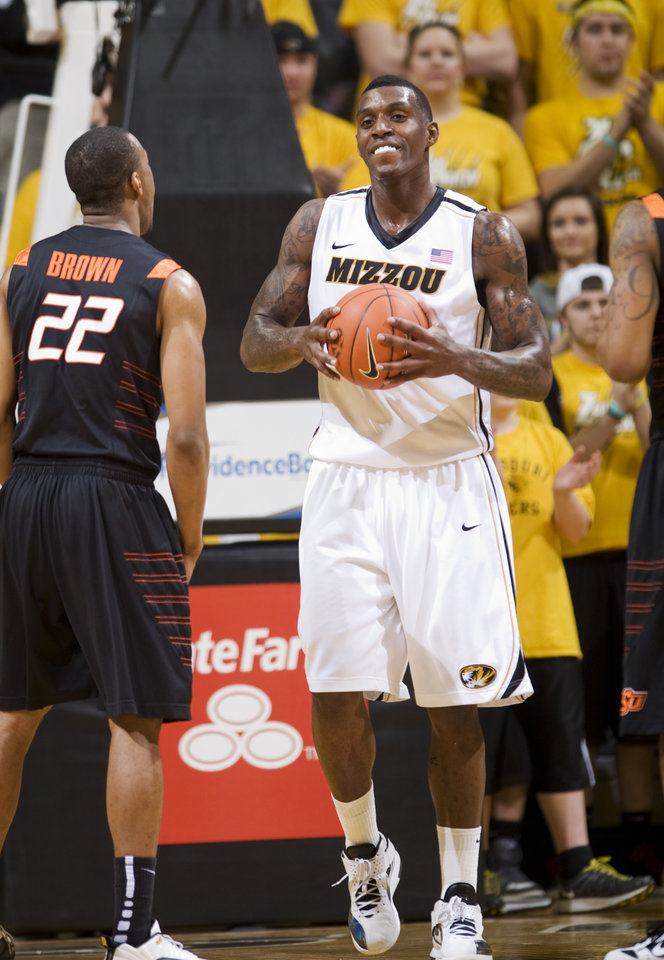 Missouri's Ricardo Ratliffe, right, holds the ball after being fouled while shooting as Oklahoma State's Markel Brown, left, walks away during the first half of an NCAA college basketball game Wednesday, Feb. 15, 2012, in Columbia, Mo. Missouri won the game 83-65. (AP Photo/L.G. Patterson) ORG XMIT: MOLG104