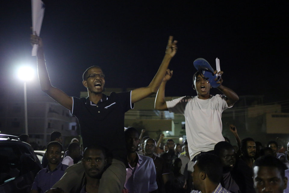 Photo - Sudanese anti-government protesters chant slogans during a demonstration in Khartoum, Sudan, Sunday, Sept. 29, 2013. Thousands of Sudanese protesters took to the streets in night march in the capital Khartoum late Sunday. (AP Photo/Khalil Hamra)