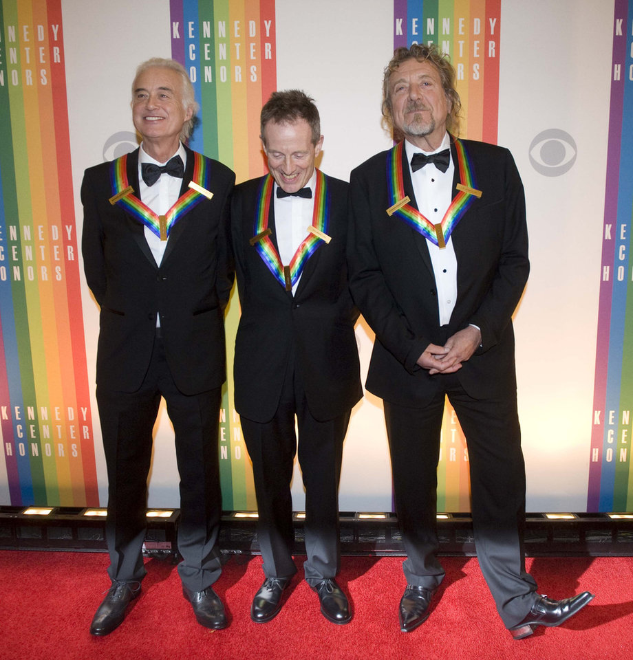 Photo - 2012 Kennedy Center Honorees and members of the band Led Zeppelin, from left, Jimmy Page, John Paul Jones, and Robert Plant arrive at the Kennedy Center for the Performing Arts for the 2012 Kennedy Center Honors Performance and Gala Sunday, Dec. 2, 2012 at the State Department in Washington. (AP Photo/Kevin Wolf)