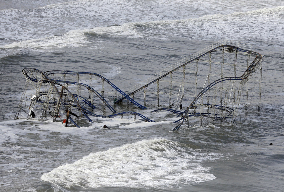 Photo -   Waves wash over a roller coaster from a Seaside Heights, N.J. amusement park that fell in the Atlantic Ocean during superstorm Sandy on Wednesday, Oct. 31, 2012. New Jersey got the brunt of the massive storm, which made landfall in the state and killed six people. More than 2 million customers were without power as of Wednesday afternoon, down from a peak of 2.7 million. (AP Photo/Mike Groll)