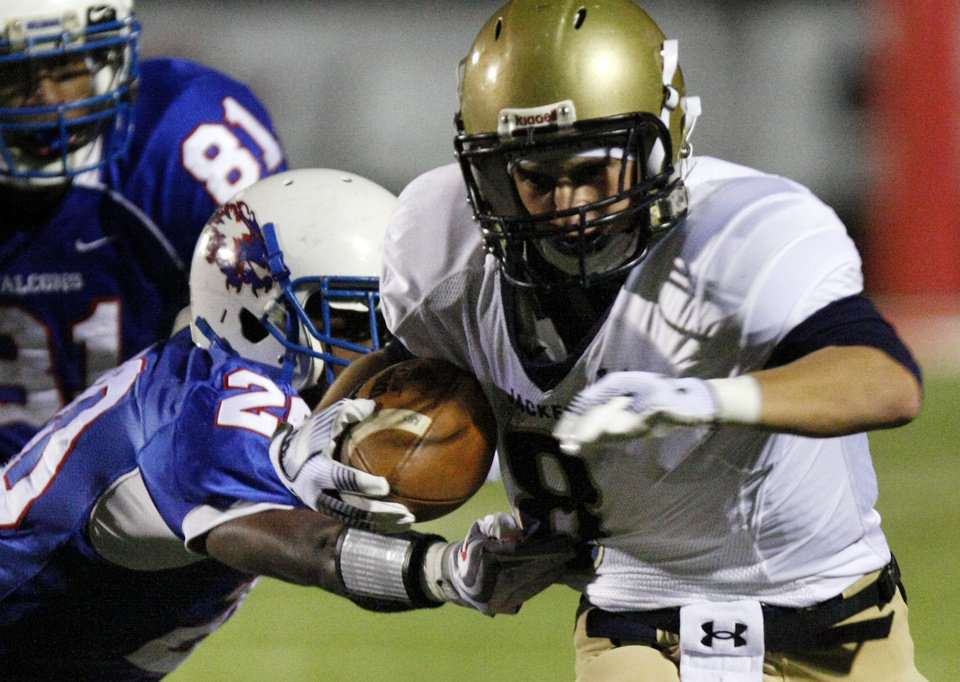 Photo - Kingfisher's Jeremy Smith (8) gets past Millwood's Allen Starks (20) during the Class 2A State semifinal football game between Millwood High School and Kingfisher High School on Saturday, Dec. 5, 2009, in Yukon, Okla. Photo by Chris Landsberger, The Oklahoman