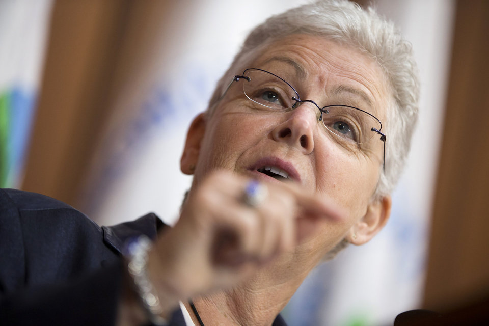 Photo - Environmental Protection Agency (EPA) Administrator Gina McCarthy gestures during an announcement of a plan to cut carbon dioxide emissions from power plants by 30 percent by 2030, Monday, June 2, 2014, at EPA headquarters in Washington. In a sweeping initiative to curb pollutants blamed for global warming, the Obama administration unveiled a plan Monday that cuts carbon dioxide emissions from power plants by nearly a third over the next 15 years, but pushes the deadline for some states to comply until long after President Barack Obama leaves office. (AP Photo/ Evan Vucci)