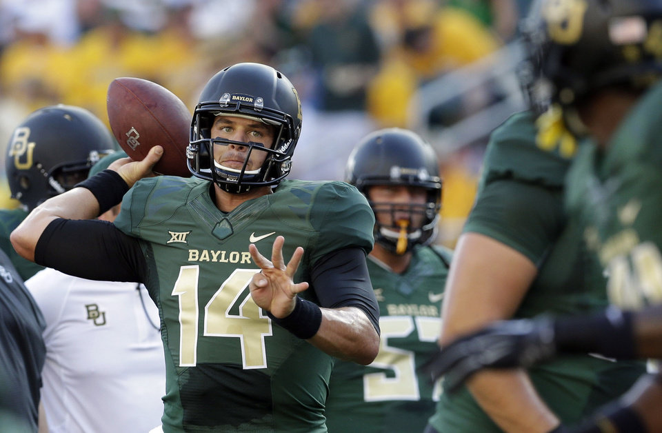 Photo - Baylor quarterback Bryce Petty (14) warms up before an NCAA college football game against SMU, Sunday, Aug. 31, 2014, in Waco, Texas. (AP Photo/LM Otero)