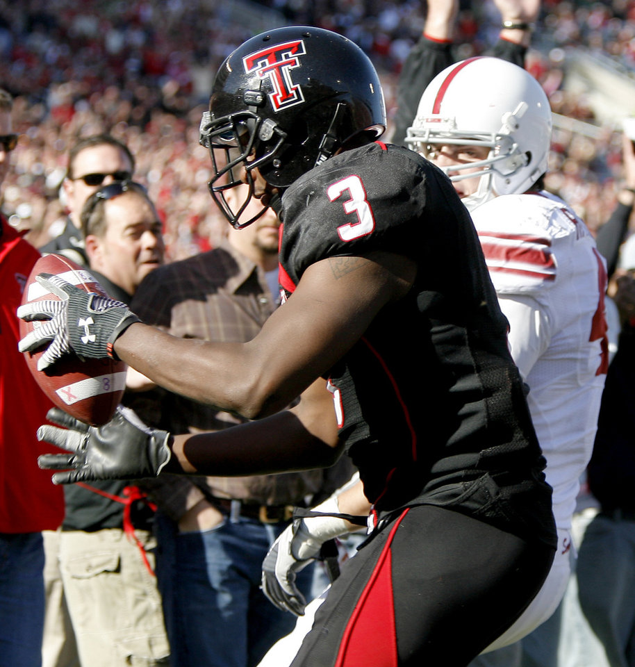 Photo - Texas Tech's Jamar Wall intercepts a Ryan Broyles' pass intended for OU's Trent Ratterree during the college football game between the University of Oklahoma Sooners (OU) and Texas Tech University Red Raiders (TTU ) at Jones AT&T Stadium in Lubbock Okla., Saturday, Nov. 21, 2009. Photo by Bryan Terry, The Oklahoman