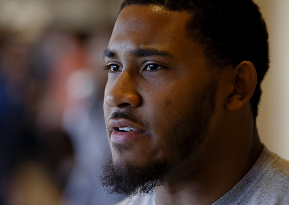 Photo - Oklahoma State linebacker Ryan Simmons speaks during a press conference before the start of spring football practice at Oklahoma State University in Stillwater, Okla., on Monday, March 10, 2014.  Photo by Chris Landsberger, The Oklahoman