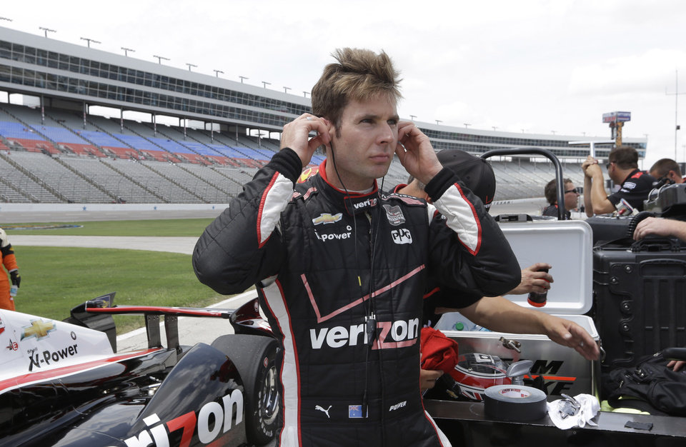 Photo - Will Power of Australia stands next to his car after qualifying for the pole position in the IndyCar auto racing at Texas Motor Speedway in Fort Worth, Friday, June 6, 2014. (AP Photo/Tim Sharp)