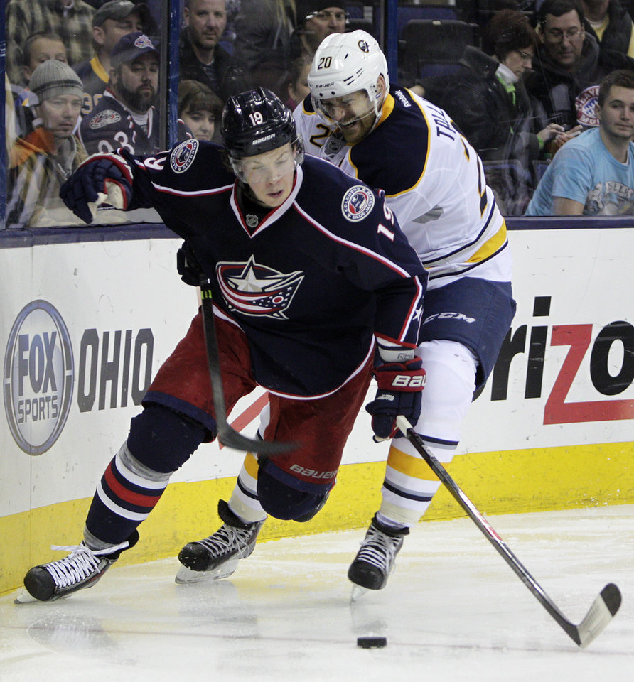 Photo - Buffalo Sabres' Henrik Tallinder, right, of Sweden, tries to steal the puck from Columbus Blue Jackets' Ryan Johansen during the second period of an NHL hockey game, Saturday, Jan. 25, 2014, in Columbus, Ohio. (AP Photo/Jay LaPrete)