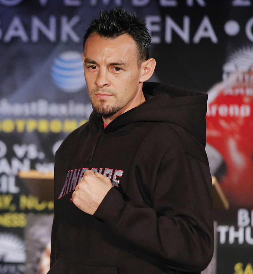 FILE - In this Oct. 23, 2012 file photo, boxer Robert Guerrero is photographed during a news conference in Los Angeles. Guerrero was arrested at New York\'s Kennedy Airport after police said he tried to bring a gun on a plane. Queens District Attorney Richard Brown said Guerrero was arrested Thursday, March 28, 2013, when he presented a locked gun box to a ticket agent during check-in. The 30-year-old Guerrero is the former featherweight champion and current WBC welterweight champion. (AP Photo/Jae C. Hong, file)