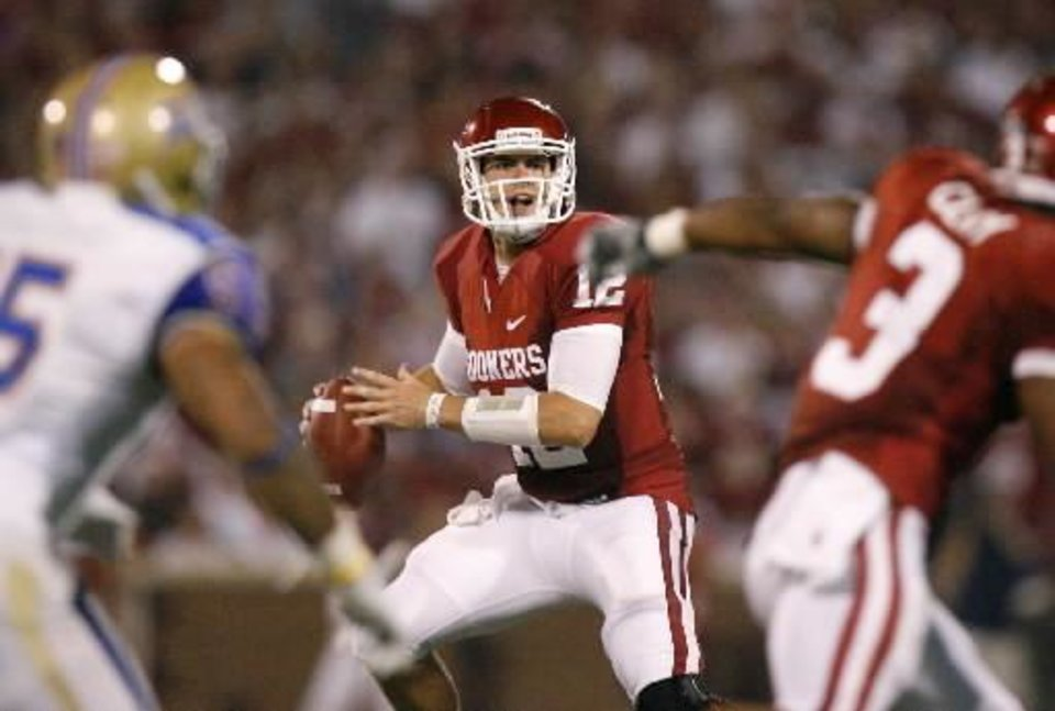 Photo - Oklahoma's Landry Jones (12) drops back to pass during the college football game between the University of Oklahoma Sooners ( OU) and the Tulsa University Hurricanes (TU) at the Gaylord Family-Memorial Stadium on Saturday, Sept. 3, 2011, in Norman, Okla. Oklahoma won 47-14. Photo by Bryan Terry, The Oklahoman ORG XMIT: KOD