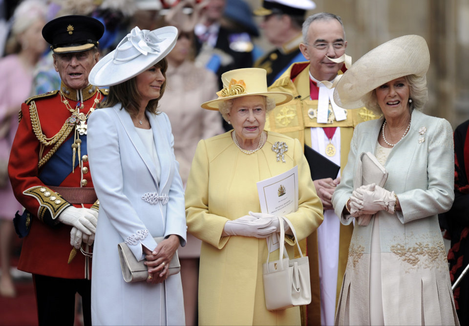 Photo - From left, Prince Phillip, Carole Middleton, Britain's Queen Elizabeth II and Camilla, Duchess of Cornwall stand outside of Westminster Abbey after the Royal Wedding in London Friday, April, 29, 2011. (AP Photo/Martin Meissner)