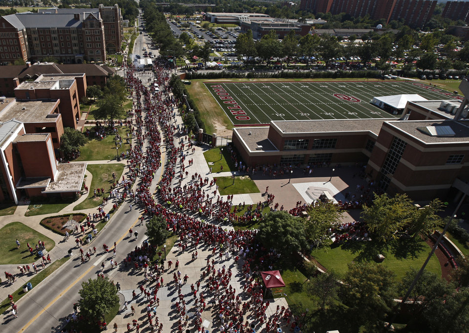 Photo - Fans line up to greet the Oklahoma football during the team's Walk of Champions before a college football game between the University of Oklahoma Sooners (OU) and the Louisiana Tech Bulldogs at Gaylord Family-Oklahoma Memorial Stadium in Norman, Okla., on Saturday, Aug. 30, 2014. Photo by Bryan Terry, The Oklahoman