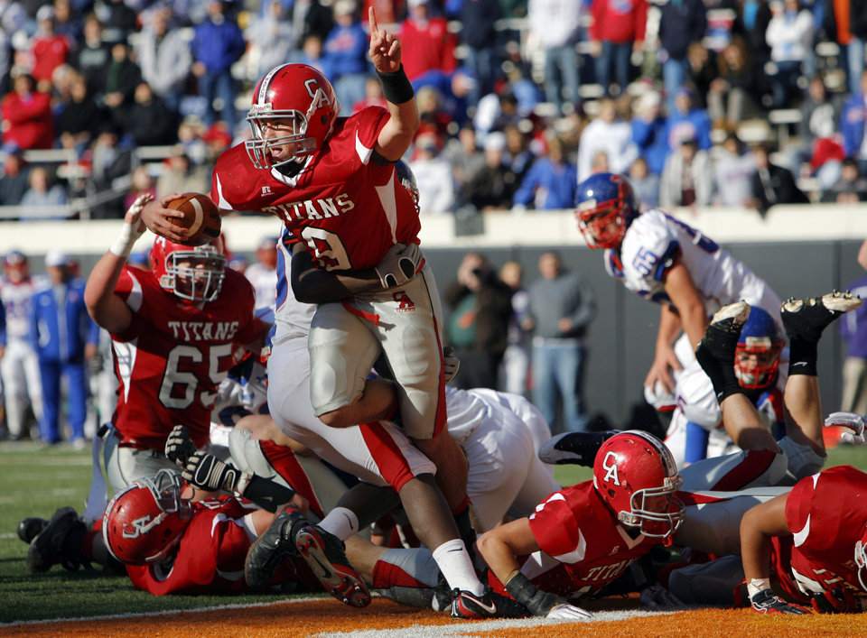 Photo - Carl Albert quarterback J.T. Realmuto (9) celebrates after rushing for touchdown in the first quarter during the Class 5A state high school football championship game between Bixby and Carl Albert at Boone Pickens Stadium in Stillwater, Okla., Saturday, December 5, 2009. Carl Albert won, 21-7.  Photo by Nate Billings, The Oklahoman