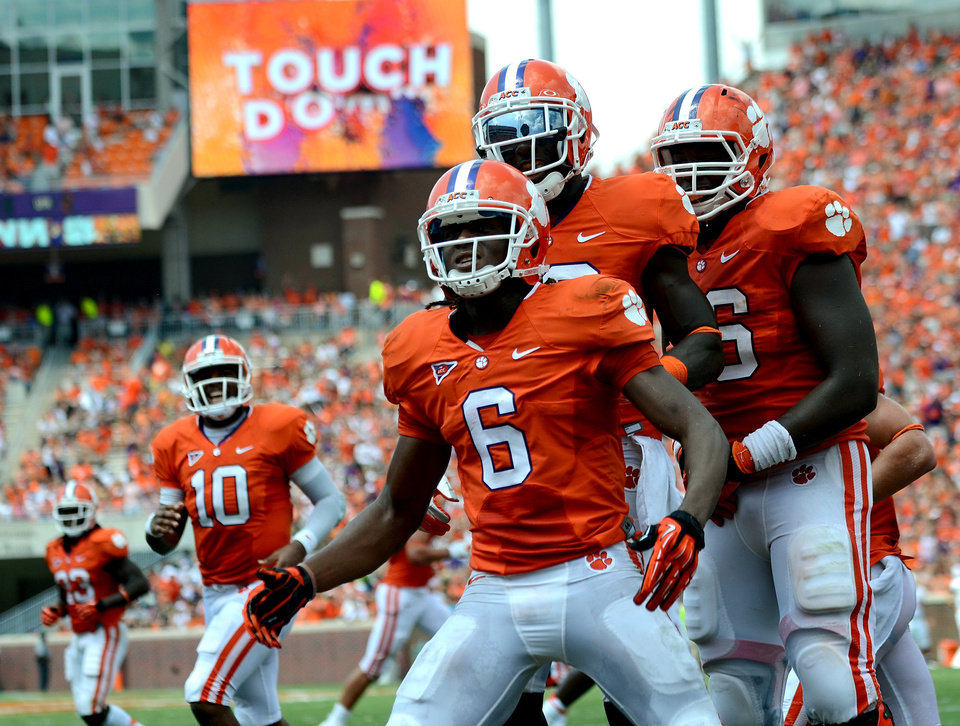 Photo -   DeAndre Hopkins (6) celebrates a touchdown during the first half of an NCAA college football game against Ball State Saturday, Sept. 8, 2012 at Memorial Stadium in Clemson S.C. (AP Photo/ Richard Shiro)