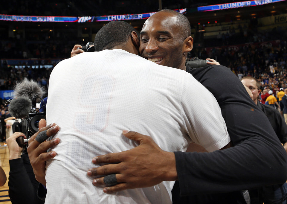 Photo - Los Angeles' Kobe Bryant (24) hugs Oklahoma City's Serge Ibaka (9) after an NBA basketball game between the Oklahoma City Thunder and the Los Angeles Lakers at Chesapeake Energy Arena in Oklahoma City, Monday, April 11, 2016. [Nate Billings/The Oklahoman]