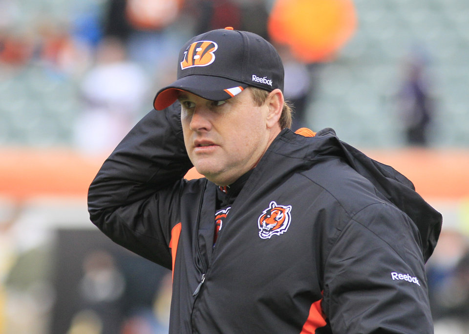 Photo - FILE - In this Jan. 1, 2012 file photo, Cincinnati Bengals offensive coordinator Jay Gruden walks on the field prior to an NFL football game against the Baltimore Ravens, in Cincinnati. Jay Gruden has agreed to become the head coach of the Washington Redskins. The Redskins confirmed Thursday, Jan. 9, 2014,  that Gruden has accepted the job and will be introduced at an afternoon news conference. (AP Photo/Al Behrman, File)