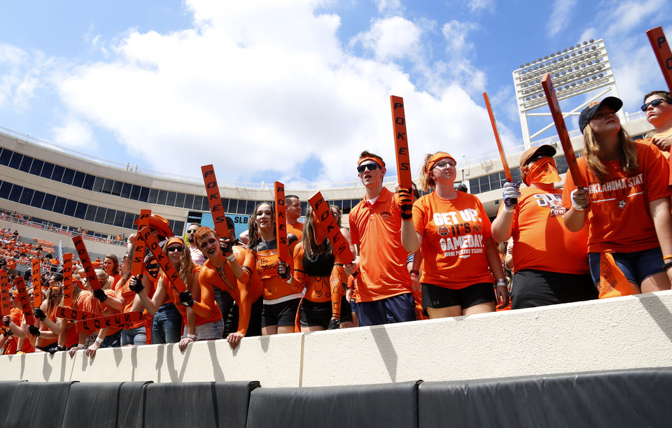 Photo - Fans cheer before the college football game between the Oklahoma State Cowboys (OSU) and the Southeastern Louisiana Lions at Boone Pickens Stadium in Stillwater, Okla., Saturday, Sept. 12, 2015. Photo by Sarah Phipps, The Oklahoman