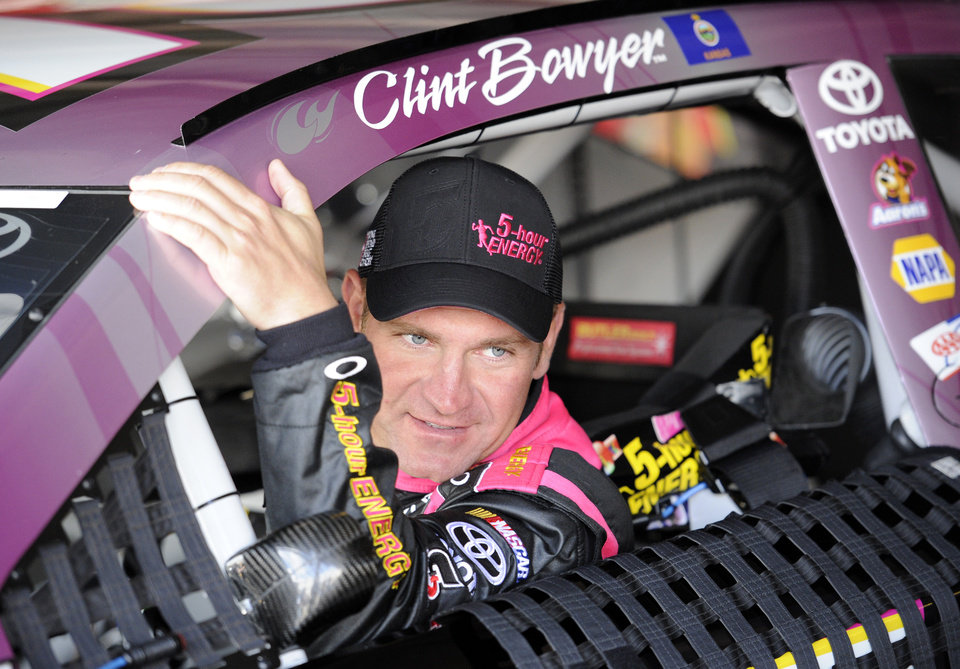 Photo - Clint Bowyer climbs into his car for practice for Sunday's NASCAR Sprint Cup series auto race, Saturday, Sept. 28, 2013, at Dover International Speedway in Dover, Del. (AP Photo/Nick Wass)