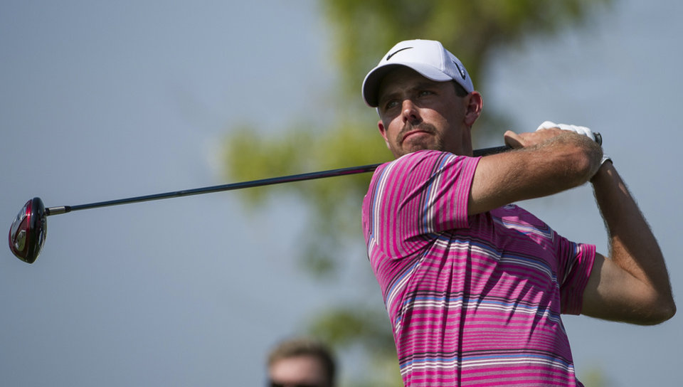 Photo -   Charl Schwartzel from South Africa tees off on the 8th hole during the final round of the DP World Golf Championship in Dubai, United Arab Emirates, Sunday, Nov. 25, 2012. (AP Photo/Stephen Hindley)