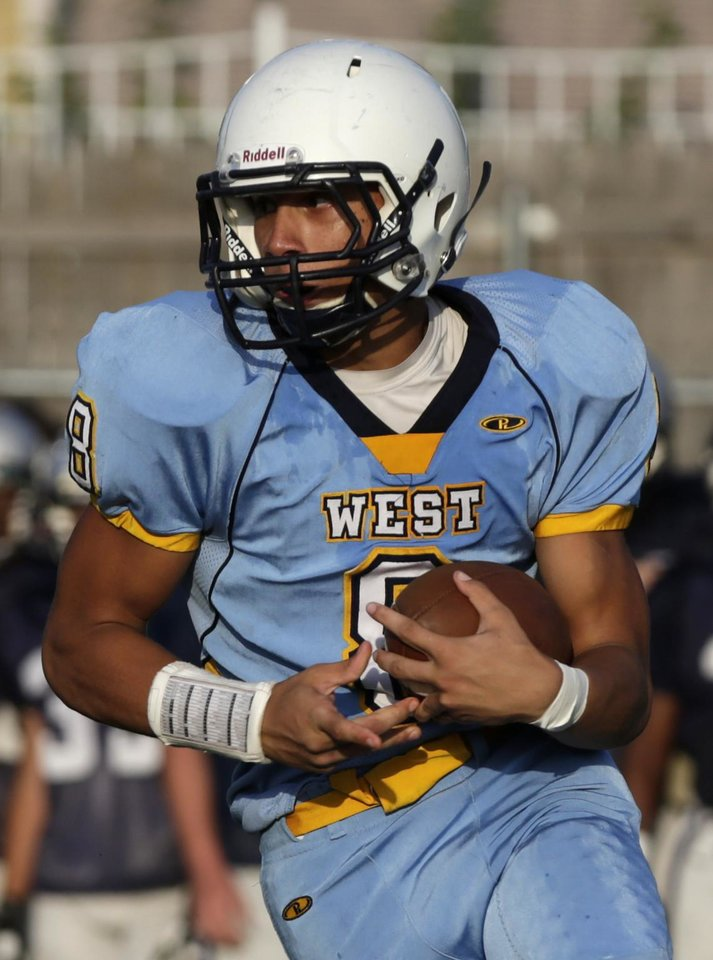 Photo - Putnam City West's Nic Farmer (8) runs the ball during a scrimmage at Putnam City West High School in Bethany, Thursday, Aug. 21, 2014.  Photo by Garett Fisbeck, For The Oklahoman
