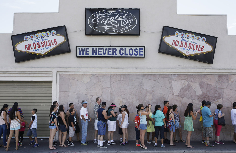 Photo - People wait in line to enter the Gold & Silver Pawn Shop in Las Vegas Monday, July 28, 2014, in Las Vegas. Rick Harrison, owner of the pawn shop and one of the stars of the reality television series Pawn Stars, has proposed building a shopping plaza on land nearby. (AP Photo/John Locher)