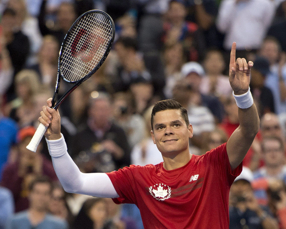 Photo - Milos Raonic, of Canada, celebrates his 6-3, 4-6, 6-4 win over Julien Benneteau, of France, during a Rogers Cup tennis match in Toronto on Thursday, Aug. 7, 2014. (AP Photo/The Canadian Press, Frank Gunn)