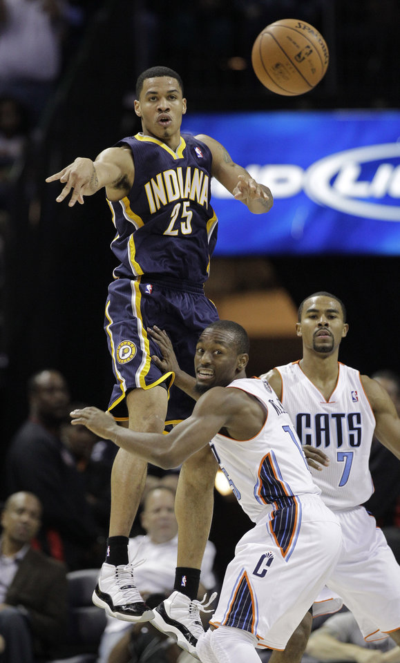 Indiana Pacers\' Gerald Green (25) passes the ball as he is defended by Charlotte Bobcats\' Kemba Walker and Ramon Sessions (7) during the second half of an NBA basketball game in Charlotte, N.C., Friday, Nov. 2, 2012. The Bobcats won 90-89. (AP Photo/Chuck Burton)