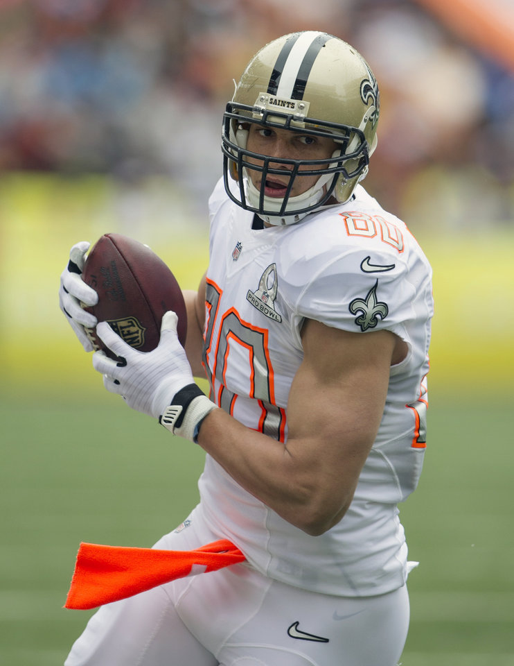Photo - New Orleans Saints tight end Jimmy Graham (80), of Team Rice, makes a catch during the first quarter at the NFL Pro Bowl football game at Aloha Stadium, Sunday. Jan. 26, 2014, in Honolulu. (AP Photo/Marco Garcia)